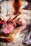 Rare Rectangle of Lamb on Wooden Cutting Board Royalty Free Stock Photography