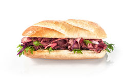 Rare roast beef and fresh rocket on a baguette Royalty Free Stock Photo