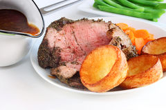 Rare roast beef and mini yorkshire puddings stock image