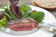 Rare roasted rib eye steak Stock Photo