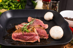 Rare Seasoned Beef Slices Sizzling in Hot Fry Pan Stock Photography