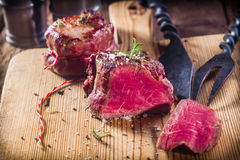 Rare Seasoned Boar Filets on Wooden Board Royalty Free Stock Photo