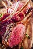 Rare Seasoned Lamb Chops on Wooden Cutting Board Stock Photos
