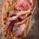 Rare Seasoned Lamb Chops on Wooden Cutting Board Stock Photography