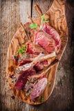 Rare Seasoned Lamb Chops on Wooden Cutting Board Royalty Free Stock Photo