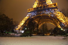Rare snow in Paris near Eiffel Tower. Night picture of rare snow around the Eiffel Tower in Paris Royalty Free Stock Photography
