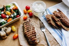 Rare steak with light spring salad royalty free stock photography