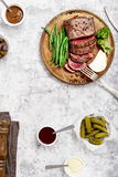 Rare steak with side dish of French beans and broccoli Royalty Free Stock Photo