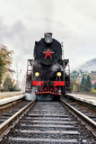 Rare steam train locomotive preparing for departure from railway station, vertical image Royalty Free Stock Images