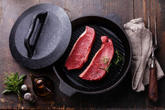 Rare Striploin steak on grill pan Royalty Free Stock Photo