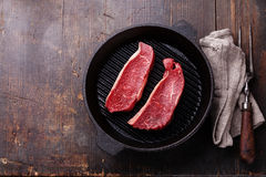 Rare Striploin steak on grill pan Royalty Free Stock Images