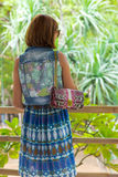 Rare view of fashion young caucasian woman with handmade snakeskin python handbag. Sunny day on a tropical Bali island Stock Photography