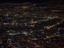 Rare view of Paris from the sky. Taken from a plane, a cityscape of Paris by night with the Eiffel Tower as central subject Stock Photo