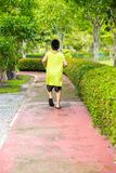 Rare view of young asian boy run in garden. royalty free stock photos
