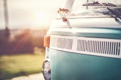 Rare vintage camper van. Renovated car of 70`s, nice old vintage blue bus, happy travel in exclusive car on bright sunny day stock photography