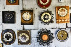 Rare watch. On the wall are hanging old clock. royalty free stock photos