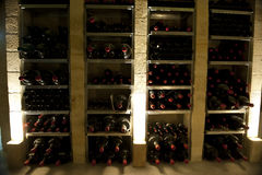 Rare magnum wine bottles in Bordeaux. Wine racks filled with magnum bottles and rare wines Stock Photos