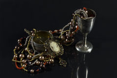 Rarity tableware with jewelry. Royalty Free Stock Images