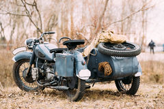 Rarity Three-Wheeled Motorcycle With Sidecar Of German Forces Of. The Old Rarity Tricar, Three-Wheeled Gray Motorcycle With A Sidecar Of German Forces Of World Stock Photo