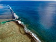 Rarotonga waves on the reef Polynesia Cook Island tropical paradise aerial view stock photo