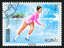 Figure Skating at Olympics. RAS AL KHAIMA - CIRCA 1972: stamp printed by Ras al Khaima, shows Figure Skating at Olympics, circa 1972 Royalty Free Stock Photos