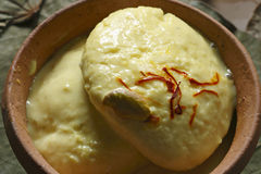 Ras Malai - A sweet dish from Bengal. Ras Malai is a sweet dish invented in Bengal and found in India.Ras malai consists of sugary, cream to yellow-colored balls royalty free stock photography