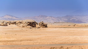 Ras Mohammed desert. In the picture the rocky desert that surrounds the national park of Ras Mohammed in Egypt , and in the background the mountains of Sinai royalty free stock image