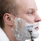 rasatura dell'uomo Immagine Stock