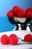 Rasberries. Plate and bowl of fresh raspberry stock photography