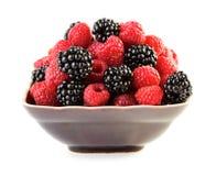 Rasberries and blackberries in plate Stock Photo