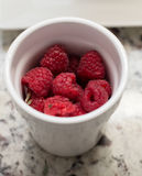 Rasberries in a Cup Stock Photography