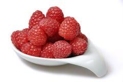 Rasberries en un plato Foto de archivo libre de regalías