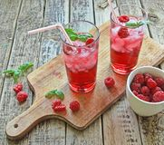 Rasberries juice Stock Photos