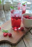Rasberries juice with ice Stock Photos