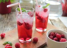 Rasberries juice with ice Royalty Free Stock Photography