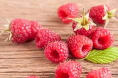 Rasberry on background. Fresh rasberry on wooden background. Natural food Stock Images
