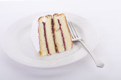 Rasberry Filled Layer Cake on White Plate Royalty Free Stock Image