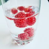 Rasberry. Fruitwater. Rasberry in Water for a healthy Life Stock Images