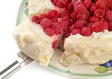 Rasberry Pavlova dessert. With cut slice, isolated on white Stock Photos