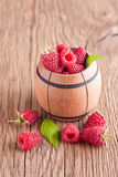 Rasberry. In wooden bowl on wooden background. Natural food Stock Photo