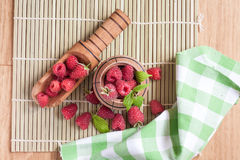 Rasberry. In wooden bowl on wooden background. Natural food Royalty Free Stock Images