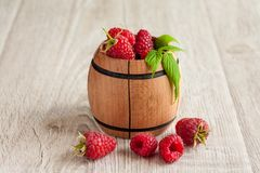Rasberry. In wooden bowl on wooden background. Natural food Royalty Free Stock Photo