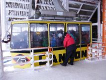 Rascal in crowded ski gondola. Little rascal in ski crowd. This ski gondola just arrived at the peak of the mountain in the Northeast USA. Not all skiers are stock photo