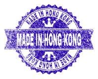Rasguñado texturizado HECHO EN sello del sello de HONG KONG con la cinta ilustración del vector
