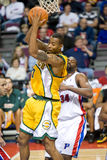 Rashard Lewis Grabs A Rebound. Rashard Lewis of the Seattle Super Sonics grabs a rebound during a game against the Detroit Pistons at the The Palace Of Auburn Royalty Free Stock Image