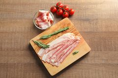 Rashers of bacon on board. Rashers of bacon on wooden board Stock Photography