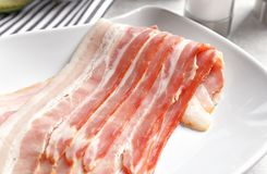 Rashers of bacon on plate. Close up Stock Images