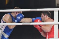 Rashid Kodzoyev (rojo) contra Alexey Emelyanov Fotografía de archivo libre de regalías