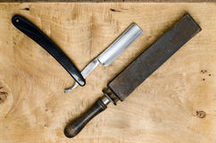 Rasiermesser und Gurt Stockfoto