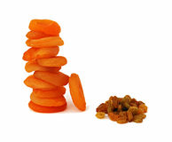 Rasins and dried apricots. Isolated on white background Royalty Free Stock Photo